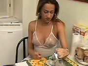 TS enjoys oral in kitchen