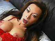 Tranny in red teases dick