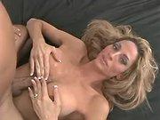 Longhaired gorgeous tranny titfucks
