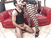 Busty Brazilian transsexual hooker in action with a man on couch
